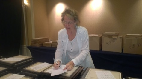 Melinda Condon prepares awards that will be handed out at the Keystone Awards banquet Saturday night at the Wyndham Gettysburg/